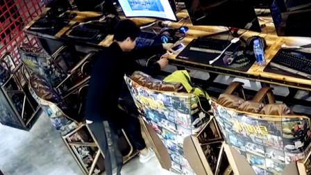 【重庆】监拍:男子网吧内2秒钟盗走顾客手机