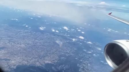 乘客在空中拍下箱体UFO画面,幸运的是手机像素也很高