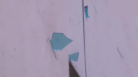 惊险!居民楼燃气爆炸 飞溅玻璃插入对面楼外墙