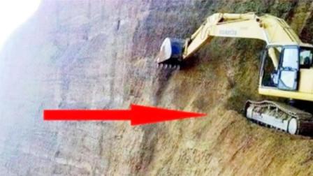 挖掘机在悬崖上工作,地下土层突然松动,镜头记录全过程