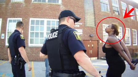 头一次见美国警察受这种气!女子当面侮辱还吐口水,警员忍了!