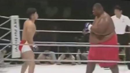 拳击史上体重最悬殊的两场比赛,挨一拳会怎样?