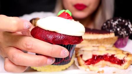 小姐姐面前有好多甜点呀,奶油芝士红丝绒纸杯蛋糕看起来非常诱人