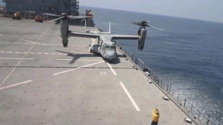 美军V-22鱼鹰倾转旋翼机在航空母舰上起降
