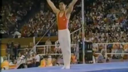 体操王子李宁,84年奥运精彩绝伦的单杠夺金成套,单臂大回环