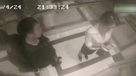 女白领在电梯里玩手机,醉酒男子如此举动,太丢人了!