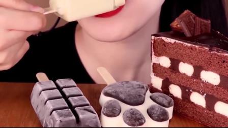 美女吃播吃造型可爱的猫爪雪糕,巧克力蛋糕更是香甜,看着太馋人了
