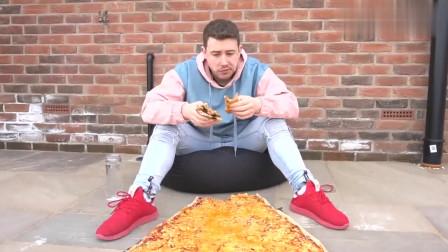 老外制作一张巨无霸披萨,大到当被子盖身上,饿了张嘴就可以吃一口!