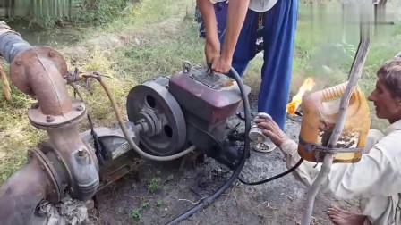 牛人发明:烧着火启动柴油机,一看技巧就很熟练的样子!