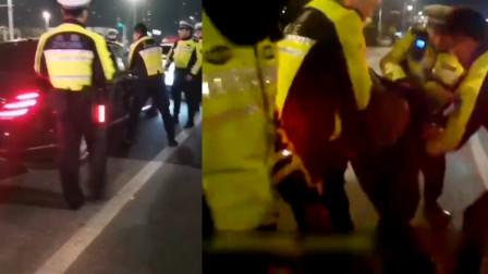 因酒驾迈巴赫司机冲卡被截停拒不下车 南京交警果断破窗抓人