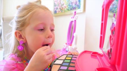 萌娃小可爱收到了超漂亮的梳妆台,小家伙把自己打扮的美美哒!太可爱啦!