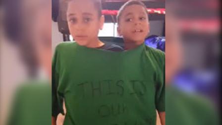 双胞胎打架,被父亲强塞进同一件T恤,网友:终于找到解决方法了