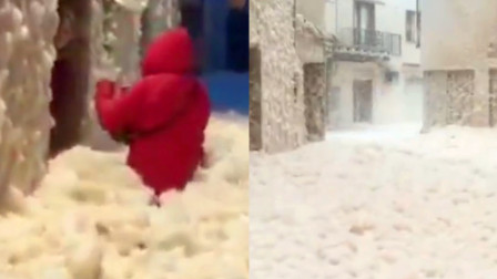 西班牙一度假村被海水泡沫入侵 实拍:女子齐腰海水泡沫中行走