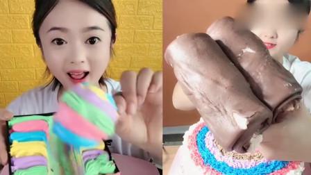 美女吃播:奶油棒棒糖、可可蛋糕卷,甜甜的,看着就想吃