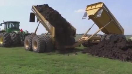 两节车厢卸车技术含量很高,重型拖拉机牵引两节全挂车厢卸料