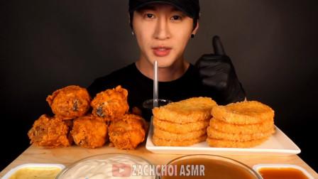 韩国大胃王吃一份炸鸡腿,搭配炸猪排蘸着酱汁往嘴里塞,真过瘾!
