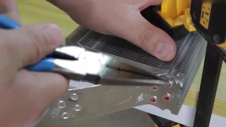 把风冷散热器的铜管割掉,再套上几根水管,高端水冷散热就完成了