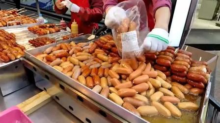 韩国街头小吃:香肠串,香香脆脆的,干净卫生,感觉很有食欲