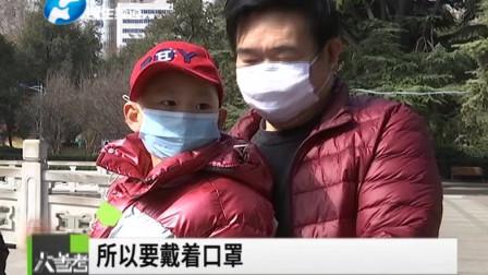 天气放晴郑州各大公园人流渐增,切记戴口罩