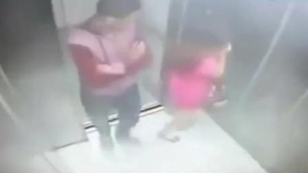 红裙妹子背对男子坐电梯,监控拍下荒唐的画面