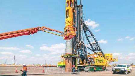 230吨打桩机的施工现场,20米长的钢管瞬间砸入地底,太壮观了