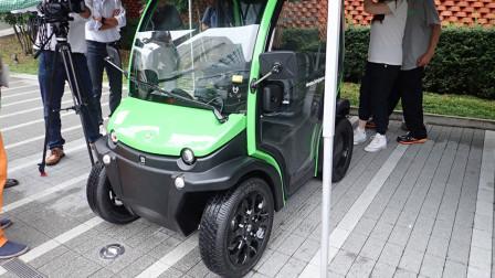 日本四轮迷你电动车,最高时速达45千米,身高1.8米的人进去很憋屈