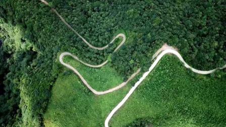 航拍广西山村道路,这一开车不小心就跌入悬崖,这是很危险山路