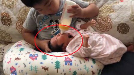 哥哥第一次喂二胎妹妹,动作熟练呵护有加,网友:别人家的哥哥