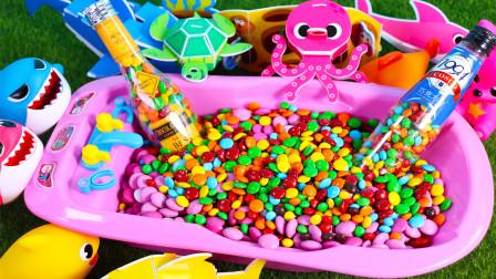 小熊盒状巧克力豆和蝴蝶形状巧克力豆 粉色浴缸装满彩虹豆