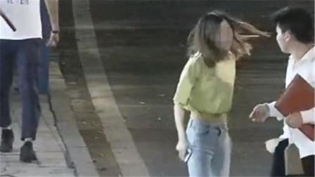 女子情绪激动割伤手腕 多次冲向车流被好心路人救下