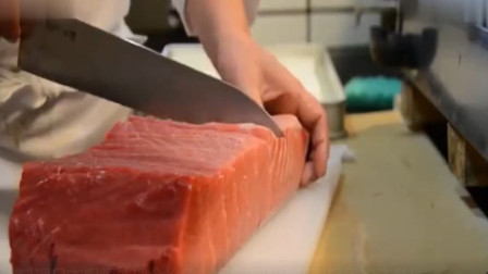 日本料理日本厨师处理金枪鱼,而它的肉质却引起我的注意!