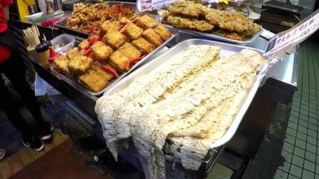 香港街头小吃,功夫鱿鱼丝,看起来很好吃,不知道味道怎么样?