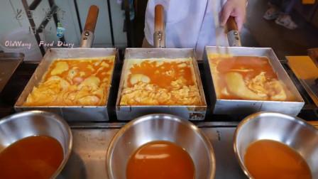 日本路边美味小吃:煎蛋卷,网友:看上去很好吃的样子,我选择中国的鸡蛋卷