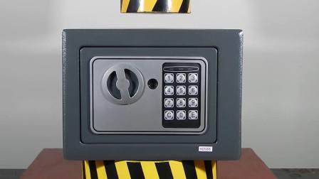 保险箱能抗住液压机吗?小伙作死测试,压下瞬间画面太硬核