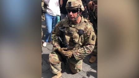 美国黑人女子劝国卫队加入 荷枪实弹士兵集体跪地表支持