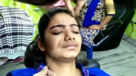 女子体验印度挽面手艺,一个细线就将眉毛和脸上的毛修得干干净净