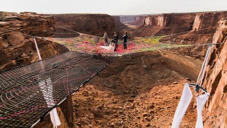 小夫妻悬崖边上办婚礼,百米高空走绳子,网友:惊险刺激