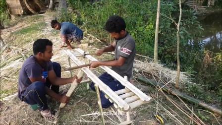 外国乡村农民工匠制作的竹子跷跷板非常有创意,点赞