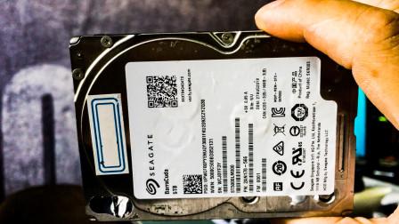 真好奇这块网友的5T硬盘到底经历了什么?拆开发现磁头已经脱落了