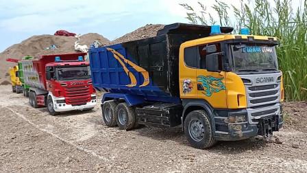 彩色卡车玩具前往建筑工地运输沙土