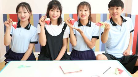 老师教学生做创意折纸,用卡纸折出红红的草莓盲盒,真好看