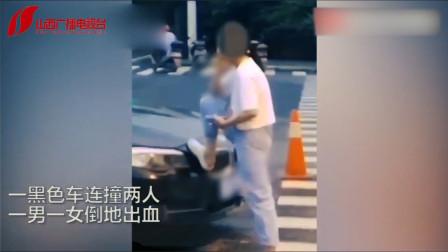 连撞2人后,绍兴宝马女口叼烟卷脚踩车头,伤者还躺在马路上
