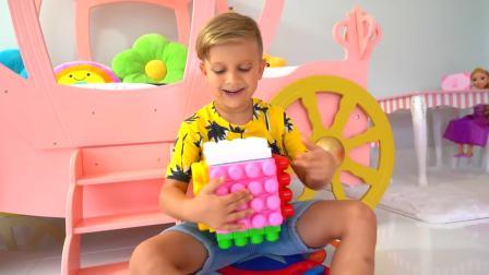 美国儿童时尚,小美女和罗玛,一块玩玩具积木真高兴