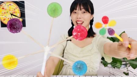 """小姐姐吃""""大风车棒棒糖"""",色彩绚丽有创意,甜度适中味道好"""