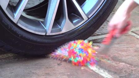 减压实验:牛人把减压球、糖果、蜡烛放在车轮下,好减压,勿模仿