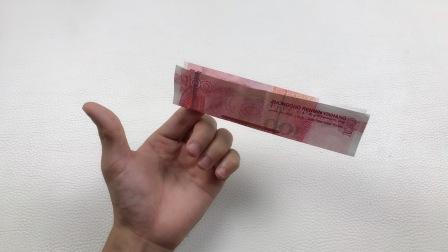魔术揭秘:为什么钞票会在指尖上面悬浮?