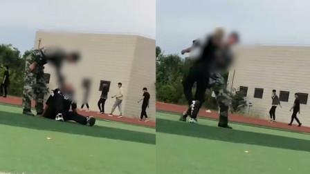 河南一军训教官殴打学生掐脖颈 官方:责成培训机构辞退涉事教官