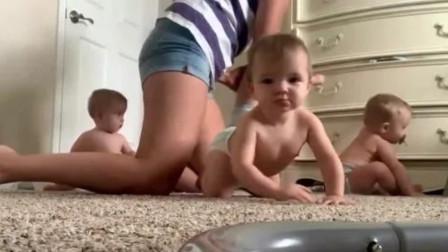妈妈给四胞胎换尿不湿,换好一个爬走一个,四个奶娃爬的遍地都是