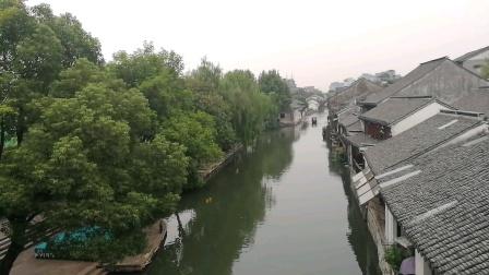 南浔古镇绿树葱葱、小桥流水、行船荡漾