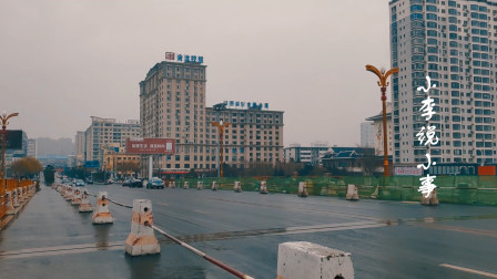 吉林省第三大城市,火车站站前街,冬雨中的散步(7)